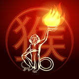 Fire Monkey Symbol. Monkey holding fire in his hand. Eastern Symbol of next year Royalty Free Stock Image