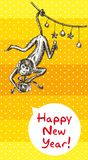 Fire Monkey Year. Monkey hanging on the garland and keeps Christmas gift Stock Images