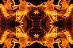 Fire mosaic. Abstract hot fire peacock feather on dark background Royalty Free Stock Images