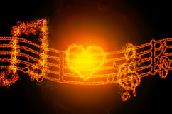 Fire musical notes sign. Abstract fire musical notes sign isolated on black background Royalty Free Stock Photography
