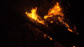 Fire in nature. Bokeh from the fire. stock footage