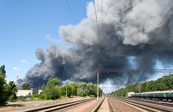 Fire near railway station Brovary royalty free stock photography