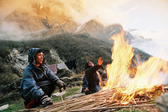 Fire, Nepal Himalaya. Porters making fire to get warm in the late fall near Annapurna mountain in Nepal. November 2007 Stock Images