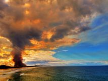 Fire next to the ocean Royalty Free Stock Images