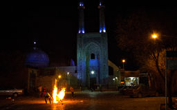 Fire night celebration in Yazd, Iran. On the Wednesday before the Iranian New Year (that in Iran is on March 21) boys light up bonfires in the streets royalty free stock photo
