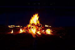 Fire at night by the lake Royalty Free Stock Photography