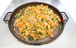 Fire noodles with vegetable, tofu and shrimp on pan ( Thailand c Stock Photos