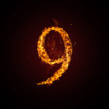 Fire number. On dark background Royalty Free Stock Images