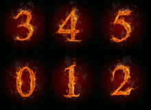 Fire numbers. Collection of burning numbers symbols, isolated on black background Royalty Free Stock Image