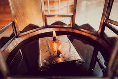 Fire from the oil lamp in temple stock images