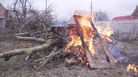 Fire from old doors and dry branches of trees. Fire from old doors and branches of trees stock footage