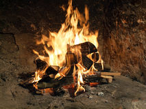 Fire in old fireplace Royalty Free Stock Image