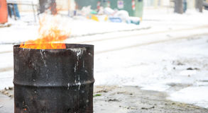 Fire in an old metal barrel Stock Photography