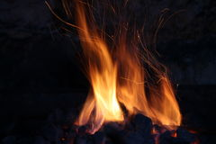 Fire in  old stone fireplace Stock Photos