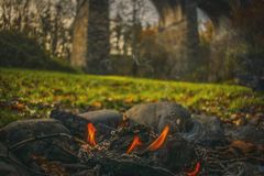Fire in the outdoor of Scotland Highlands Open fire in the forest near historic monument camping royalty free stock photos
