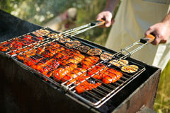 Fire on an outdoor summer BBQ or picnic. On green background royalty free stock images