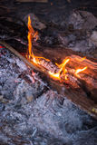 Fire in outdoors fire pit - Camp fire. Royalty Free Stock Images