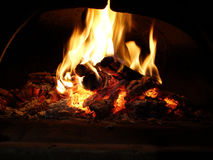 Fire on the oven Stock Photography