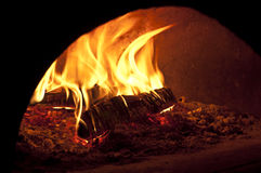 Fire oven. Fire glow pizza oven close up Royalty Free Stock Photography