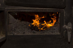 Fire in the oven Royalty Free Stock Photo