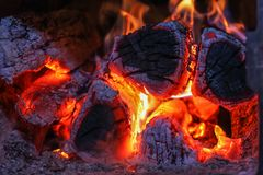 Close up shot of burning firewood in the stove. Fire in the oven. fire in a village stove for heating a home Royalty Free Stock Images