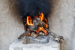 Fire of an oven of wood Stock Photos