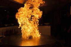 Fire over Teppanyaki grill. In chinese restaurant Royalty Free Stock Image