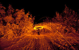 Fire painting, light painting with sparks Royalty Free Stock Photo