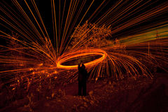 Fire painting, light painting with sparks Royalty Free Stock Photos