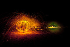 Fire painting, light painting with sparks Royalty Free Stock Photography