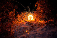 Fire painting, light painting with sparks at winter Stock Photos