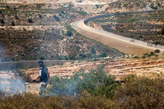 Fire in a Palestinian Field by Wall of Separation Royalty Free Stock Images