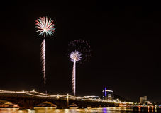 Fire Palms. This was shot at the Tempe Town Lake 4th of july Festival in Tempe, Arizona.  The Mill St. Bridge and part of Downtown Tempe are seen in the picture Royalty Free Stock Photos