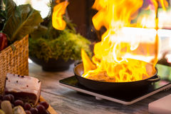 Fire in pan. Royalty Free Stock Images