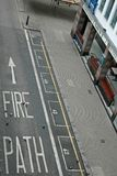 Fire Path On London Street. LONDON - CIRCA AUGUST 2006:  Fire Path painted text on a city road circa August 2006 in London, England Royalty Free Stock Photos