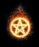 Fire pentagram. On black background Royalty Free Stock Photography
