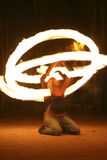 Fire Performance. Fire performer spinning poi torches at burning man festival in Nevada Stock Photos