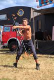 Fire performance. Man twirling a fire staff royalty free stock images