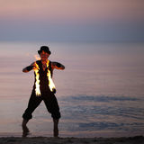 Fire performer in the sea water Stock Image