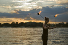 Fire Performer. Sunset fire dancing  at the beach Stock Photo