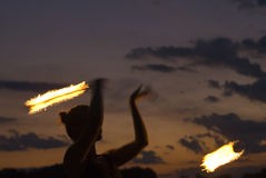 Fire Performer. Sunset fire dancing  at the beach Royalty Free Stock Photo