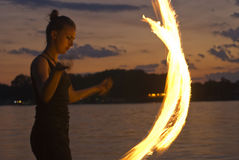 Fire Performer. Sunset fire dancing  at the beach Stock Images