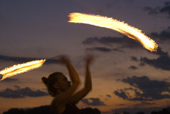 Fire Performer. Sunset fire dancing  at the beach Royalty Free Stock Images