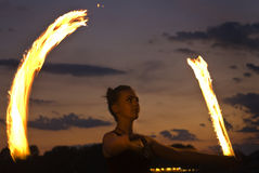 Fire Performer. Sunset fire dancing  at the beach Stock Image