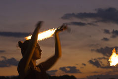 Fire Performer. Sunset fire dancing  at the beach Stock Photos
