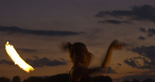 Fire Performer. Sunset fire dancing  at the beach Stock Photography