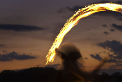 Fire Performer. Sunset fire dancing  at the beach Royalty Free Stock Photos