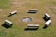 Fire Pit. Grouping of old benches around a fire pit stock photo