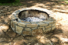 Fire Pit. An empty stone fire pit with just ashes left Royalty Free Stock Images