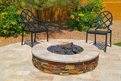 Fire pit. Beautiful outdoor fire pit constructed with colorful brick Stock Photos